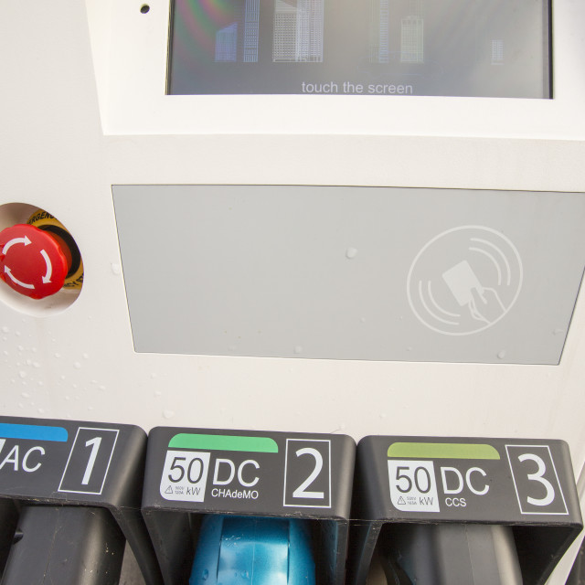 """""""An electric vehicle recharging station on a car park in Seahouses,..."""" stock image"""