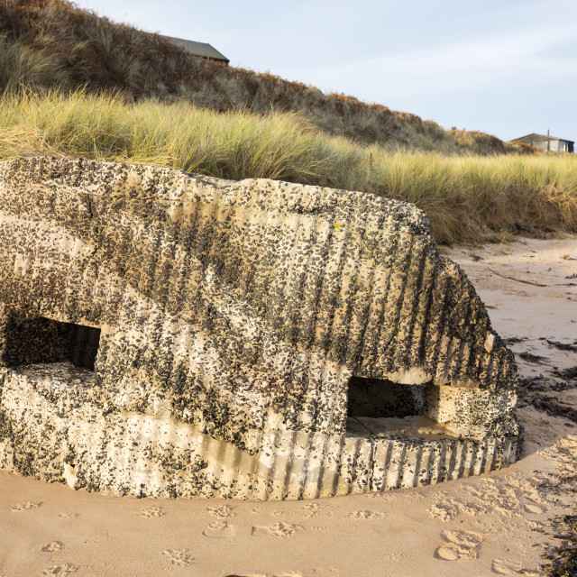 """""""A pill box on the beach at Low Newton, Northumberland, UK."""" stock image"""