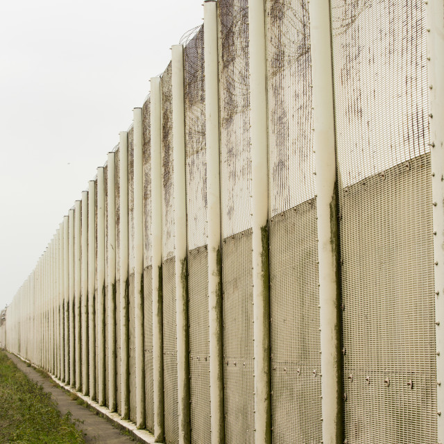 """""""The security fence at Haverigg Prison, Cumbria, UK."""" stock image"""