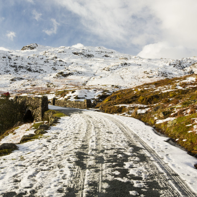 """""""Tyre tracks on Wrynose Pass which was closed by snow and ice, Lake District, UK"""" stock image"""