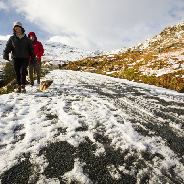 """""""Tyre tracks on Wrynose Pass which was closed by snow and ice, Lake District,..."""" stock image"""