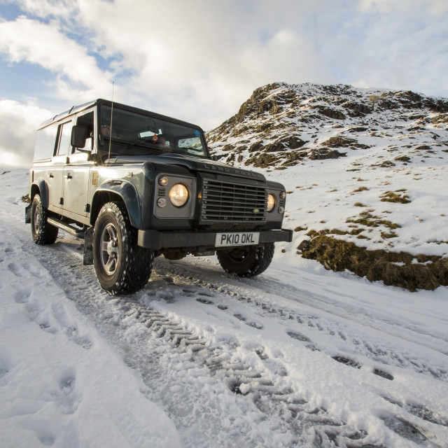 """""""A Land Rover descending Wrynose Pass in winter conditions, Lake District, UK"""" stock image"""