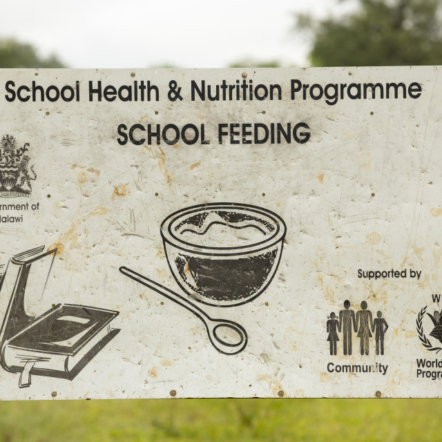 """""""A sign for a school feeding program supported by the UN World Food Program,..."""" stock image"""