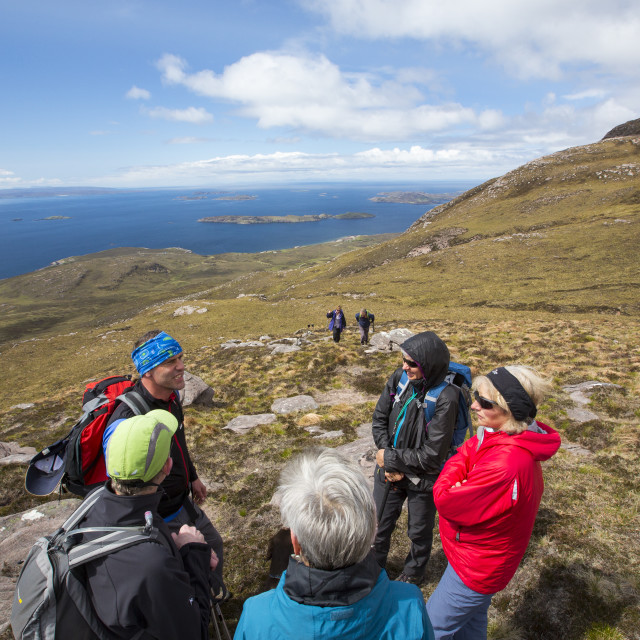 """A walking group on Ben Mor Coigach, looking towards the Summer Isles, near..."" stock image"