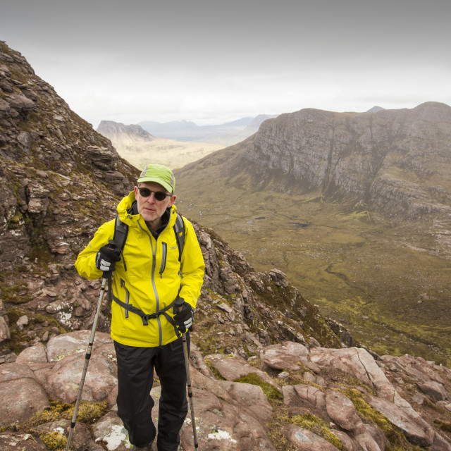 """A walker on Ben Mor Coigach, looking towards Stac Pollaidh near Ullapool,..."" stock image"