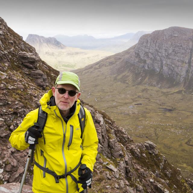 """A walker on Ben Mor Coigach, looking towards Stac Pollaidh near Ullapool,..."" stock image"