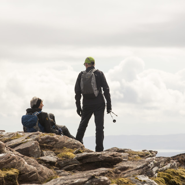 """Walkers on Ben Mor Coigach in the Scottish Highlands, above Ullapool, UK."" stock image"