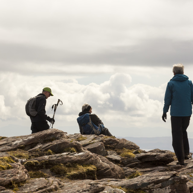 """""""Walkers on Ben Mor Coigach in the Scottish Highlands, above Ullapool, UK."""" stock image"""