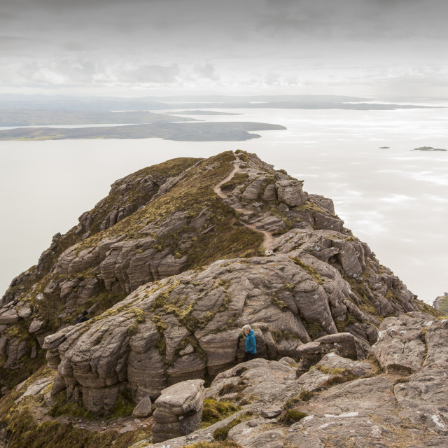 """Walkers descending Ben Mor Coigach towards Loch Broom, looking towards the..."" stock image"