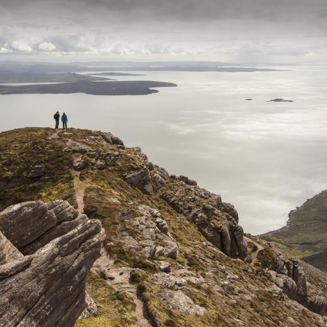"""""""Walkers descending Ben Mor Coigach towards Loch Broom, looking towards the..."""" stock image"""
