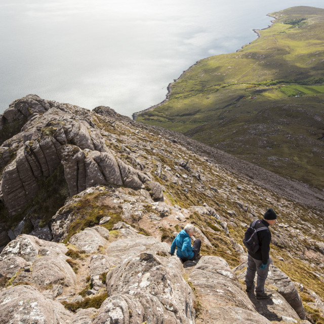 """Walkers descending Ben Mor Coigach towards Loch Broom, Highlands, Scotland, UK."" stock image"
