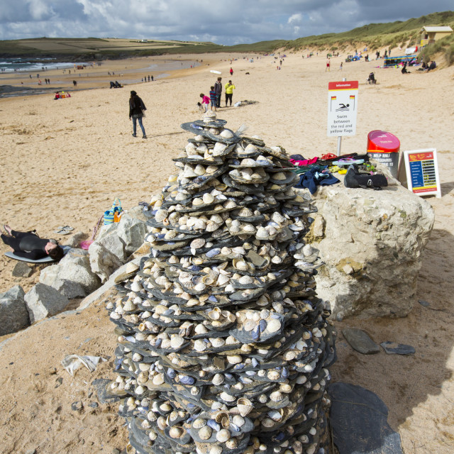"""""""A slate and limpet art cairn on Constantine Beach, Cornwall, UK."""" stock image"""