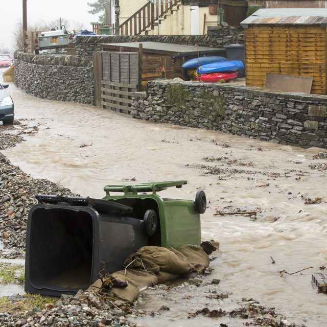 """""""A culvert overflowing and running down the street on Blue Hill, Ambleside in..."""" stock image"""