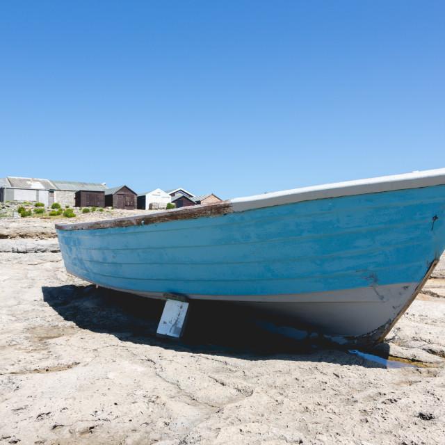 """Old vintage traditional fishing blue boat on Portland rocks"" stock image"