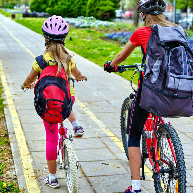 """""""Bicycle path with children. Girls wearing helmet with rucksack ."""" stock image"""