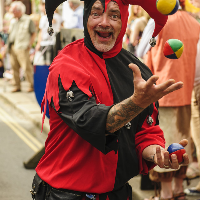 """Juggler in a jester's outfit."" stock image"
