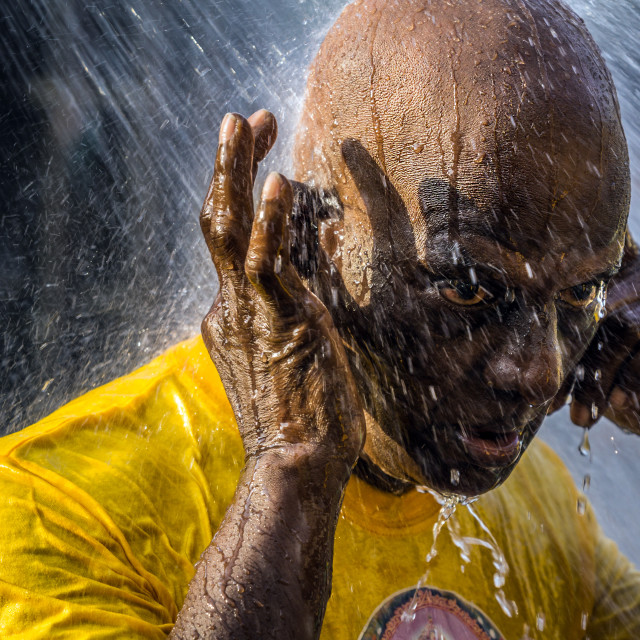 """A Hindu devotee takes a shower during Thaipusam festival to fulfil their vows and offer thanks to the deities."" stock image"