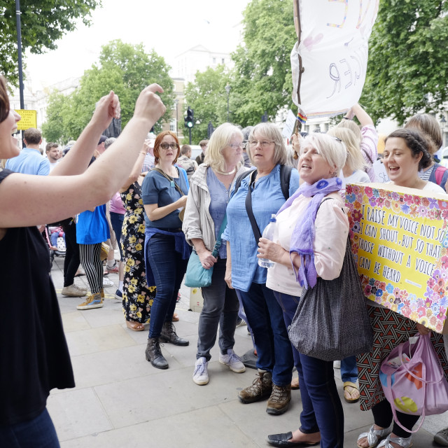 """Women activists singing at not one day more protest"" stock image"