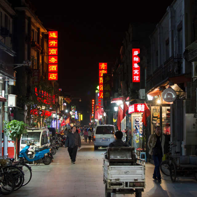 """BEIJING, CHINA - Hutong street night view with people walking"" stock image"