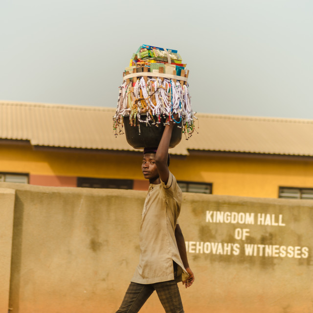 """A trader selling african handmade goods"" stock image"