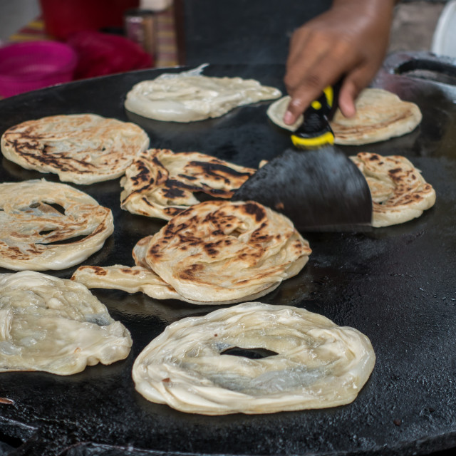 """Frying Roti Canai/Paratha"" stock image"