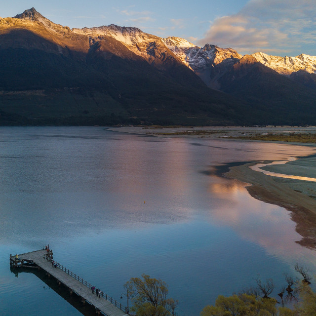 """Aerial Photo - Mountains and Lake Wakatipu at Sunrise at the famous Glenorchy town."" stock image"