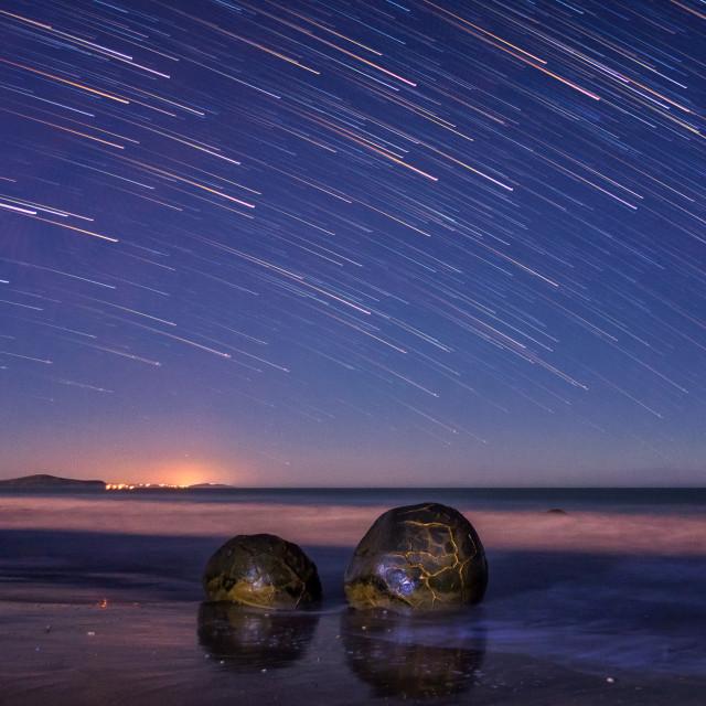 """Star trail at Moeraki Boulders, New Zealand."" stock image"
