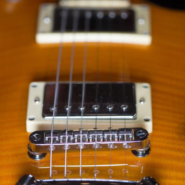 """""""Close up of an electric guitar bridge"""" stock image"""