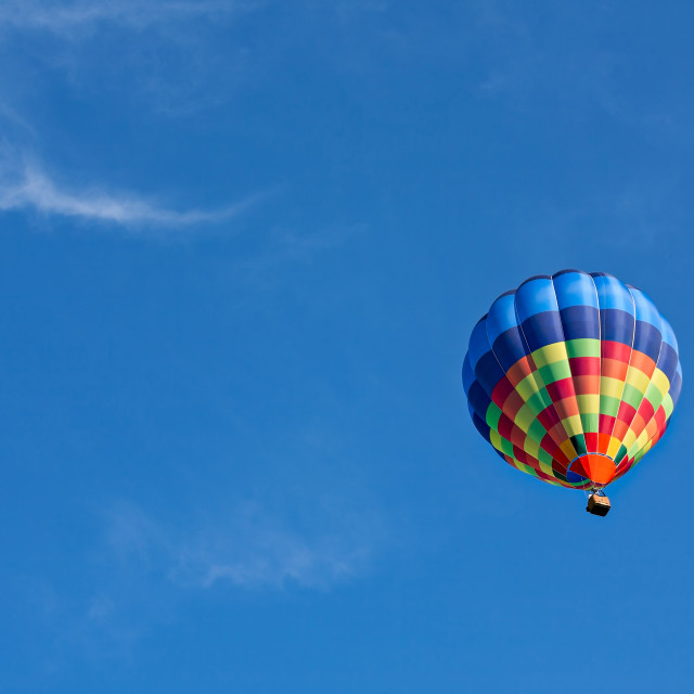 """Colorful hot-air balloon in flight"" stock image"