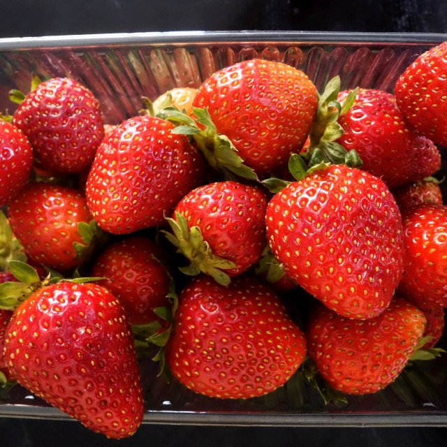 """""""Plastic Carton filled with ripe red strawberries"""" stock image"""