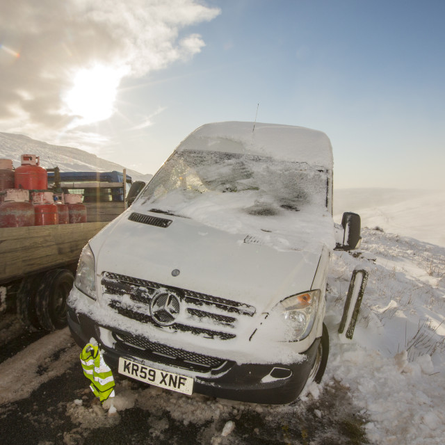"""A van abandoned on Kirkstone Pass, plastered in fresh snow after overnight..."" stock image"