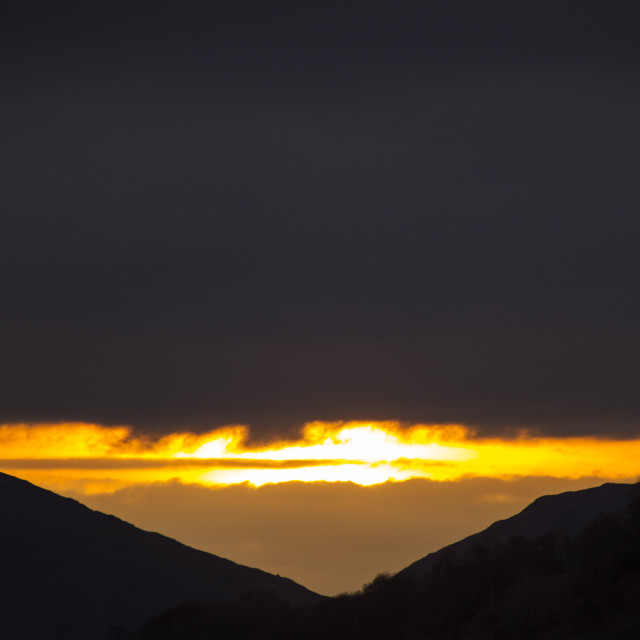 """""""Sunset over Wrynose Pass from Ambleside, Lake District, UK."""" stock image"""