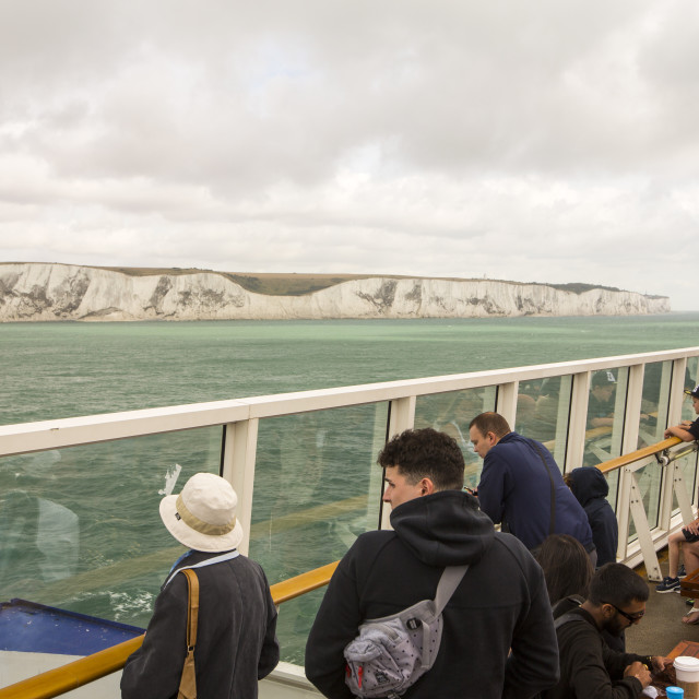 """""""A passenger ferry leaving Dover for Calais, looking back on the white cliffs..."""" stock image"""