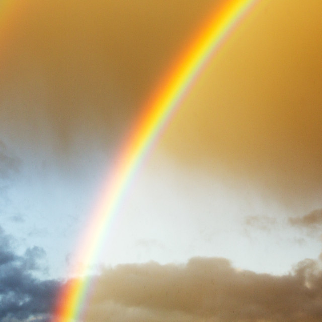"""A rainbow over Ambleside, Lake District, UK."" stock image"