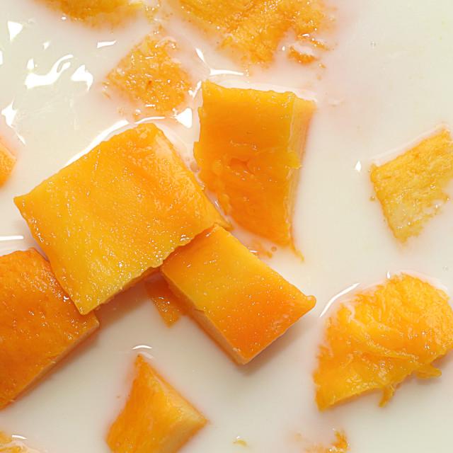 """Mango Slices in Milk"" stock image"