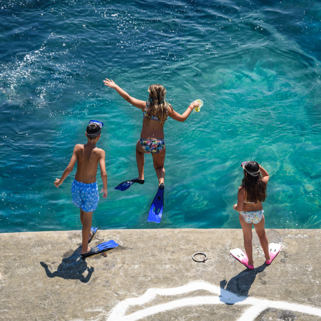 """Kids swimming on the Greek Islands"" stock image"