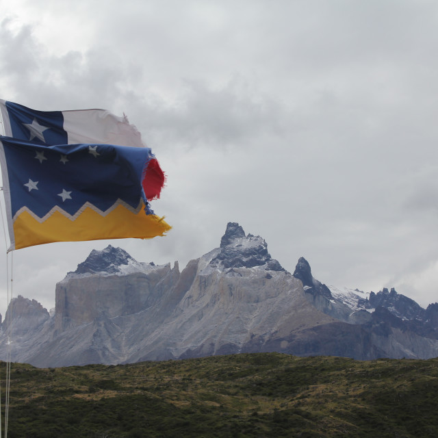 """""""Chilean and Patagonian flags at Torres del Paine"""" stock image"""