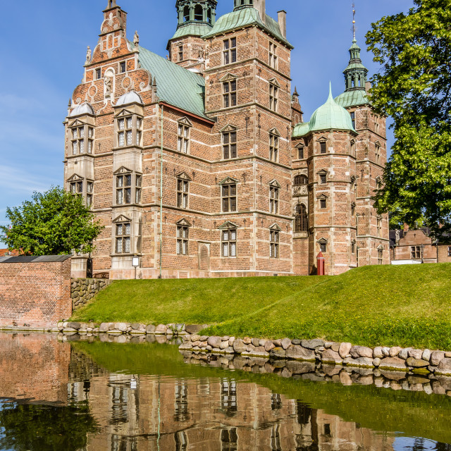 """Reflections in the moat of Rosenborg Castle in Copenhagen"" stock image"