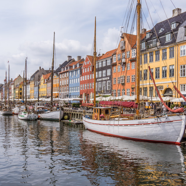 """Fishing boats in Nyhavn harbor"" stock image"
