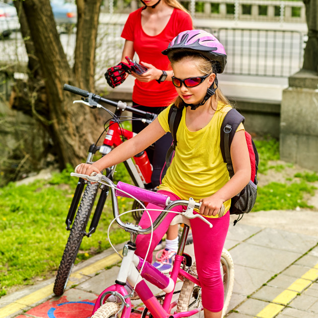 """Family bike ride with rucksack cycling on bike lane."" stock image"
