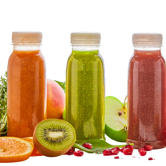 """Bottles of healthy fruit and vegetable smoothies"" stock image"