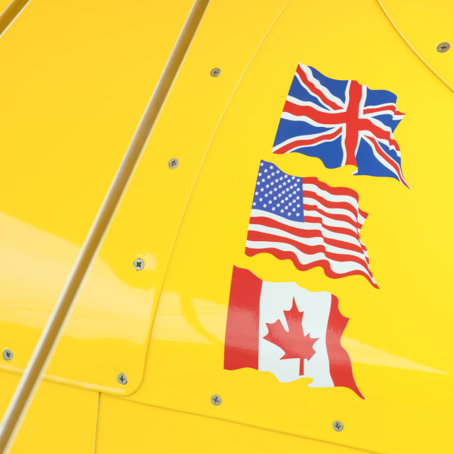 """flags on yellow"" stock image"