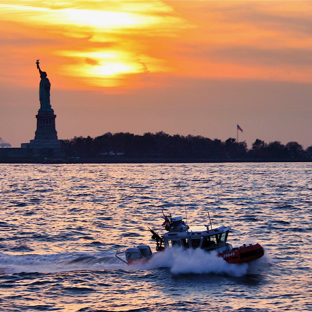 """Statue of Liberty and US Coastguard"" stock image"
