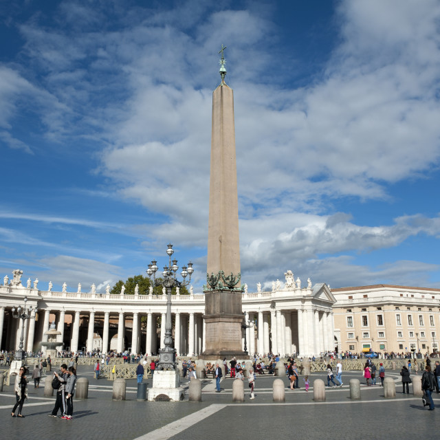 """Vatican City St Peters Square. Egyptian obelisk at the centre of the square. The obelisk was brought to Rome by the Emporer Augustus around two millenium ago."" stock image"