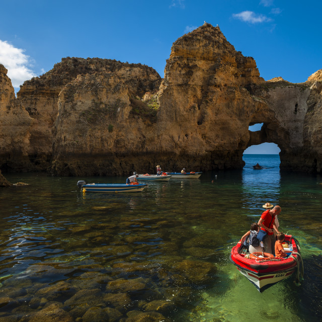 """Ponta da Piedade, Portugal - July 6, 2017: Boats in the small bay between the sandstone cliffs at the Ponta da Piedade in Lagos, Portugal"" stock image"