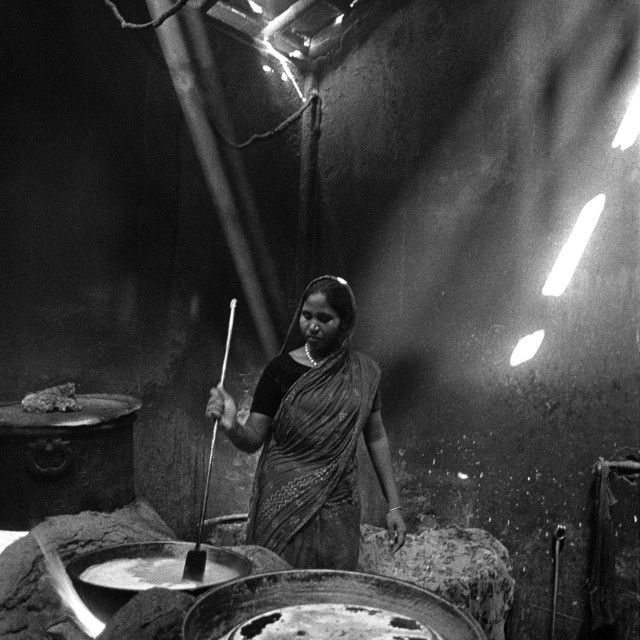 """A woman cooks at a hotel in Pabna, Bangladesh."" stock image"
