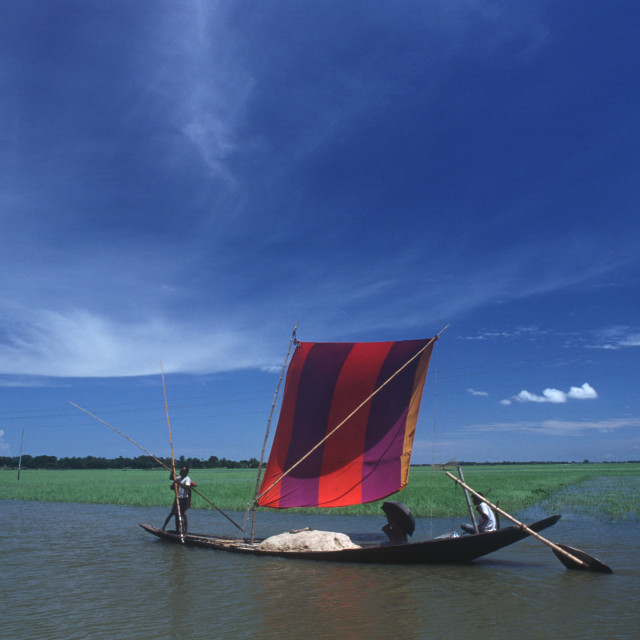 """Colourful sail boat. It is used for goods as well as people. Phandauk,..."" stock image"