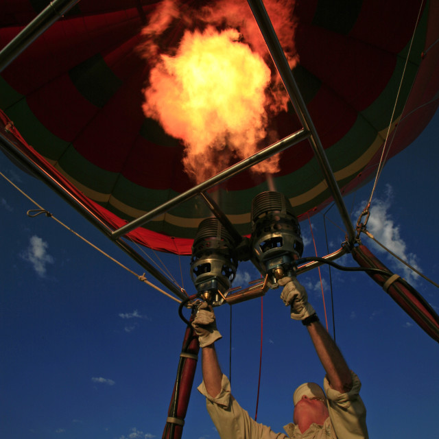 """firing the burners in a hot air balloon, Namib Desert, NamibiaMarch 20,..."" stock image"