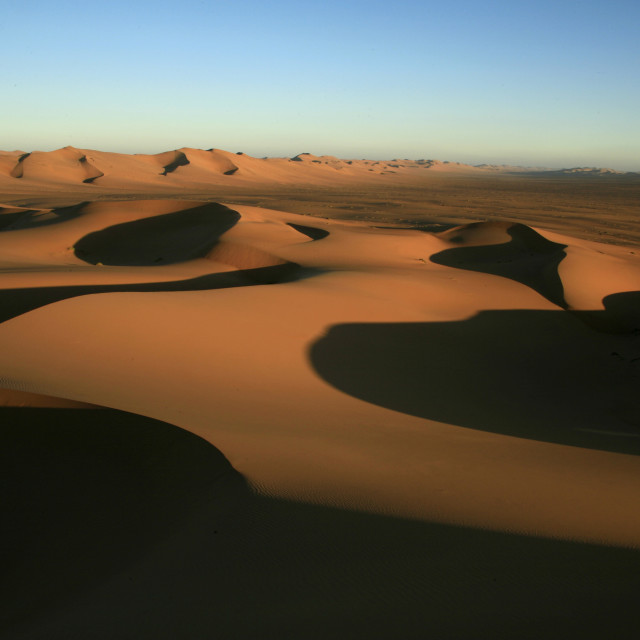 """valleys of sand dunes at sunset, Namib Desert, NamibiaMarch 23, 2010{iptc..."" stock image"