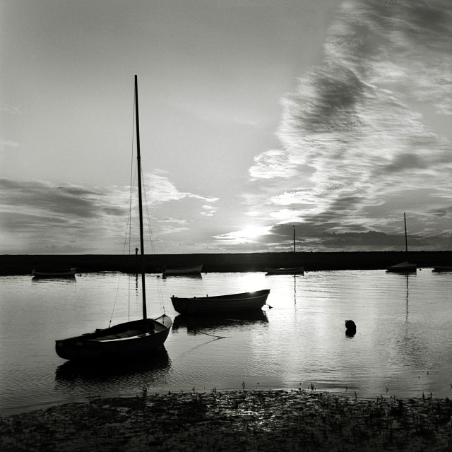 """Sunset over the harbour at Burnham Overy Staithe, Norfolk"" stock image"
